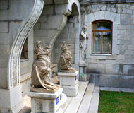 Gargoyle statues in courtyard of castle Royalty Free Stock Image