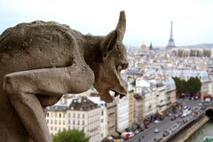 Gargoyle on top of Notre Dame de Paris. Closeup of gargoyle on top of Notre Dame de Paris Royalty Free Stock Image
