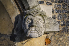 Gargoyle on Waltham Abbey Church. A gargoyle on the exterior of Waltham Abbey Church in Waltham Abbey, Essex Stock Images