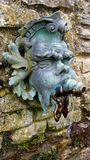 Gargoyle water feature fountain piece in garden. At national trust property Stock Image