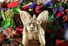Gargoyle whit dry flowers. Gargoyle with multi-coloured dry flowers Stock Photos