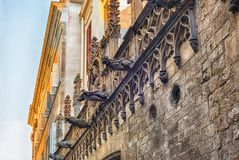 Gargoyles in Carrer del Bisbe, Barcelona, Catalonia, Spain. Gargoyles in Carrer del Bisbe, scenic street in the Gothic Quarter of Barcelona, Catalonia, Spain Stock Photography