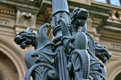 Gargoyles On lamp Post. Gargoyle Dragons on Lamp post in front of historic building Stock Images