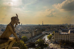 Gargoyles looking over Paris. Notre Dame Gargoyles looking over Paris at dawn Stock Photography