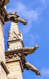 Gargoyles Sainte Chapelle Cathedral Spire Statues Paris France. Cathedral Spire Statues Gargoyles Saint Chapelle Paris France.  Saint King Louis 9th created Stock Photo