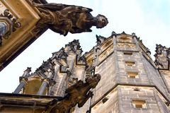 Gargoyles on St Vitus Cathedral. Gargoyles look down from the walls of Saint Vitus Cathedral in Prague stock image