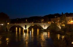 Garibaldi bridge along the Tiber. Tiber river with lights at night Stock Image