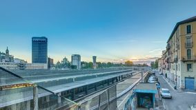 Garibaldi train station at sunset timelapse in Milan, Italy. Old and modern buildings around. Blue sky at summer day stock footage