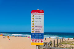 Garie beach warning sign with beach rules. NSW, Australia - January 27, 2014: Garie beach warning sign with beach rules and regulation royalty free stock image