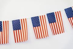 Garland of american flags of rectangular shape on light background, banner design. Fest, city street holiday. American flags of rectangular shapeon light stock photos
