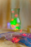 Garland. On a background of festive illuminations and decorations close-up Stock Image