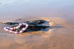 Garland on the beach at the ocean Royalty Free Stock Photography