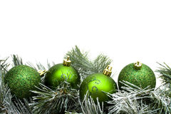 Garland Border. A green garland border with Christmas balls isolated on a white background, garland border Royalty Free Stock Image