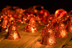 Garland from brilliant hand bells on a table Stock Image