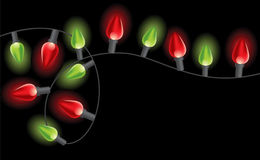 Garland of Christmas lights. Over black background Royalty Free Stock Photos
