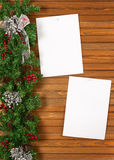 Garland with Christmas ornaments, pine cones and sheets of paper Royalty Free Stock Photos
