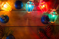 Garland and Christmas tree branches on wooden tab Stock Images