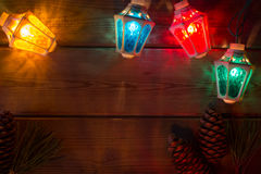 Garland and Christmas tree branches on wooden tab Royalty Free Stock Photography
