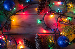 Garland and Christmas tree branches Stock Photos