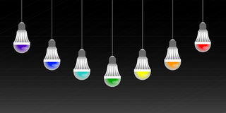 Garland of colored LED lamps on a black striped background Stock Photography