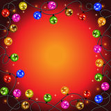 Garland with colorful balls and lights. Christmas lights. Festive garland with colorful balls and lights are connected by wires on a red background Royalty Free Stock Image