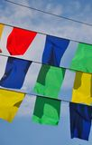 Garland of colorful flags Stock Image