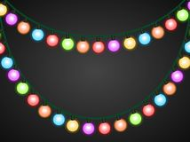 Garland of colorful glowing light bulbs. On a dark background. Vector image Royalty Free Stock Image
