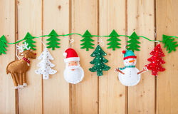 Garland with felt christmas decorations Royalty Free Stock Photo