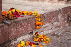 Garland. On the floor in the temple Royalty Free Stock Photos