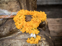 Garland flowers. On statue of buddha Stock Photos