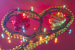 Garland in the form of heart with Christmas-toys Stock Photos