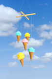 Garland in the form of ice cream. Colored ice cream fabric on sky with white clouds background Stock Photography