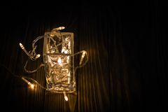 Garland in a glass. at night time royalty free stock image