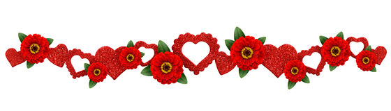Garland with glitter hearts and red zinnia flowers Royalty Free Stock Image