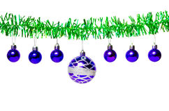 Garland of green tinsel and blue Christmas balls. Isolated on white background Stock Photography