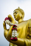 Garland in hand of buddha. Mean thai people pay respect to buddha Stock Photo
