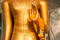 Garland on hand Buddha. Royalty Free Stock Images