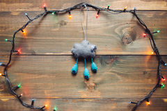 Garland and handmade christmas toy on the wooden table Royalty Free Stock Photo