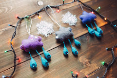 Garland and handmade christmas toys on the wooden table Stock Photos