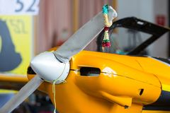Garland hanging on the airplane. Jasmin garland hanging on the airplane that park in the hangar for luck and with the hope preparing in air race Stock Images