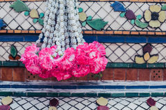 Garland hanging from buddhist altar Royalty Free Stock Photography