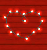 Garland heart shaped on red wooden background for Valentines Day Stock Photo