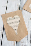 Garland with hearts in rustic style. Garland with hearts handmade in rustic-style on white wooden table Stock Images