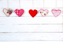 Garland of hearts on a wooden background. Valentine`s Day stock photo