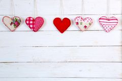 Garland of hearts on a wooden background. Valentine`s Day stock photos