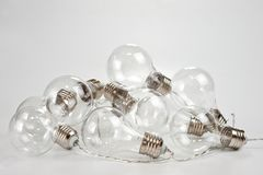 Garland of incandescent retro lamps on the old background.  Stock Images