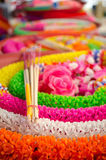 Garland, incense, candle set. Plastic garland is reuseable garland in thai temple use while worship to the buddha statue Royalty Free Stock Photography