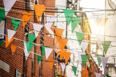 Garland with irish flag colors in a street of Dublin, Ireland - Saint Patrick day celebration concept Stock Images