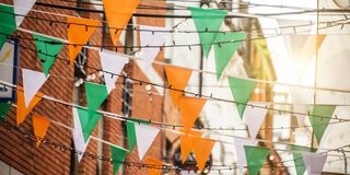 Garland with irish flag colors in a street of Dublin Ireland - Saint Patrick day celebration concept. Garland with irish flag colors in a street of Dublin royalty free stock photos