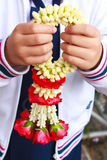 Garland of jasmine flower on hand. Royalty Free Stock Photos